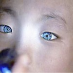 Chinese boy with blue eyes and cat-like vision