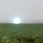 Bright UFO Travels Low Over A Siberian Field In Russia
